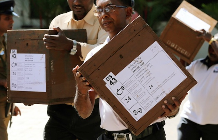 epa04549254 Election officials carry ballot boxes to polling centers one day ahead of the Presidential Elections in Colombo, Sri Lanka, 07 January 2015. The crucial Presidential election is being held two years ahead of its due date. According to the Elections Secretariat, over 15 Million are elegible to vote at about 12,000 polling centers on 08 January to elect the seventh President for another six years. EPA/M.A. PUSHPA KUMARA